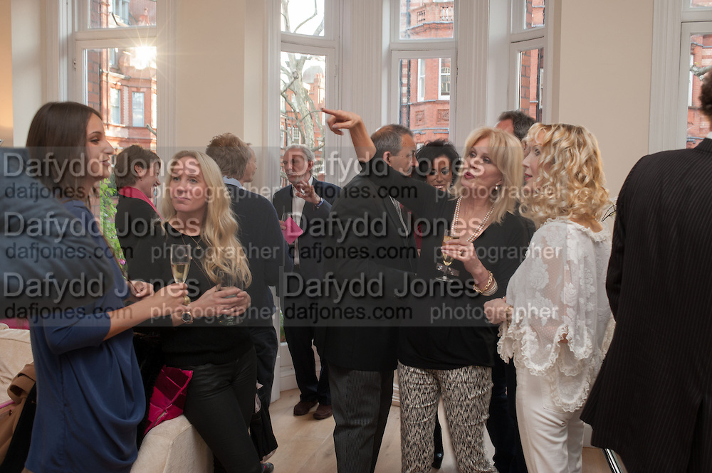 JOANNA LUMLEY; BASIA BRIGGS, Party given by Basia Briggs and Richard Briggs at their home in Chelsea. London. 14 May 2012