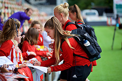 NEWPORT, WALES - Thursday, August 30, 2018: Wales' goalkeeper Claire Skinner signs autographs for young supporters after a training session at Rodney Parade ahead of the final FIFA Women's World Cup 2019 Qualifying Round Group 1 match against England. (Pic by David Rawcliffe/Propaganda)