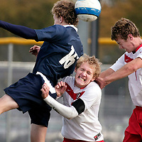 Fargo North's Elliot Radebaugh heads the ball while Shanley's Mat Glogoza, center, and Noah Harvey anticipate the deflection during the 2008 North Dakota Boys Soccer Championship at Fargo North High School Stadium.