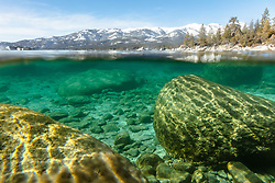"""Boulders Under Lake Tahoe 1"" - Over/Under photograph of boulders under the surface of Lake Tahoe."