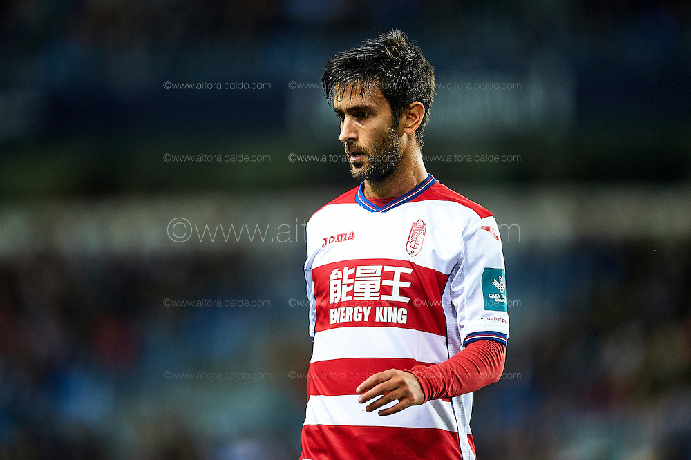 MALAGA, SPAIN - DECEMBER 09:  Alberto Bueno of Granada CF looks on during La Liga match between Malaga CF and Granada CF at La Rosaleda Stadium December 9, 2016 in Malaga, Spain.  (Photo by Aitor Alcalde Colomer/Getty Images)