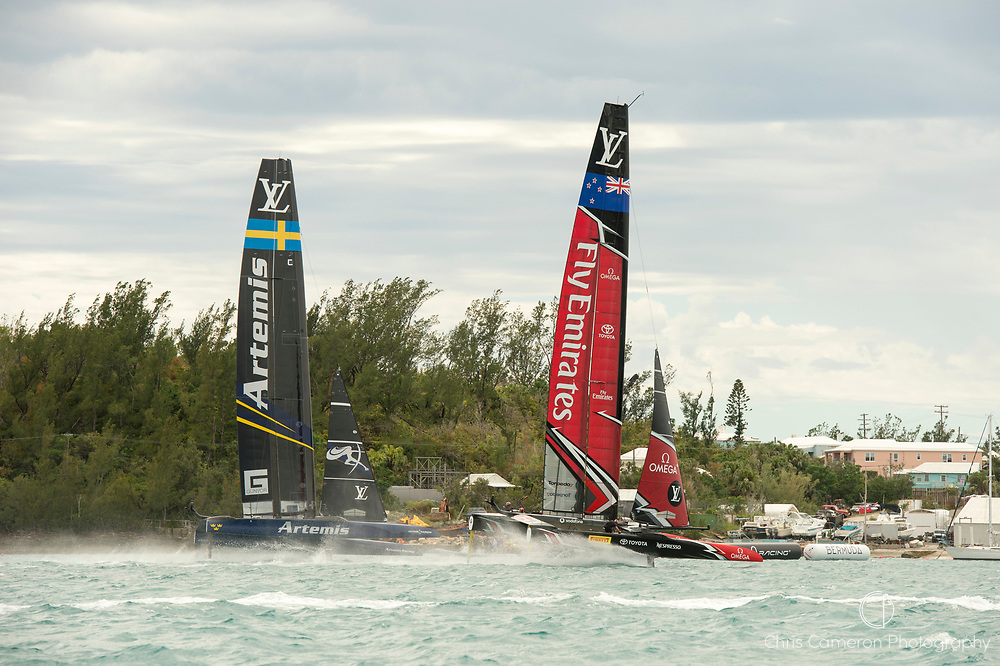 The Great Sound, Bermuda. 11th June 2017. Emirates Team New Zealand and Artemis Racing (SWE) fight for position at the finish of race six of the Louis Vuitton America's Cup Challenger playoff finals. ETNZ won by 1 second to go ahead to 4 - 2.