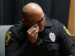 April 16, 2018 - San Antonio, Texas, U.S. - Bexar County Sheriff Deputy LOUIS ESTRADA wipes away tears after viewing crime scene photos that he was called to involving Deandre Dorch. Dorch is accused of injury to a child-serious bodily injury, in the horrific child abuse case involving two children who were found surrounded by their own feces and bound like dogs in a backyard of the Camelot II subdivision in Northeast Bexar County. The trial started on Monday, April 16, 2018 in the Felony Impact Court in the Bexar County Courthouse. (Credit Image: © Bob Owen/San Antonio Express-News/ZUMAPRESS.com)