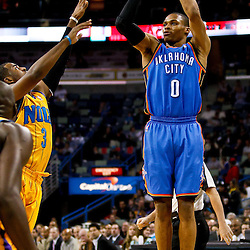 December 10, 2010; New Orleans, LA, USA; Oklahoma City Thunder guard Russell Westbrook (0) shoots over New Orleans Hornets point guard Chris Paul (3) during the first half at the New Orleans Arena.  Mandatory Credit: Derick E. Hingle-US PRESSWIRE