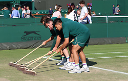 Grounds staff on court one on day eight of the Wimbledon Championships at the All England Lawn Tennis and Croquet Club, Wimbledon. PRESS ASSOCIATION Photo. Picture date: Tuesday July 10, 2018. See PA story TENNIS Wimbledon. Photo credit should read: Nigel French/PA Wire. RESTRICTIONS: Editorial use only. No commercial use without prior written consent of the AELTC. Still image use only - no moving images to emulate broadcast. No superimposing or removal of sponsor/ad logos. Call +44 (0)1158 447447 for further information.
