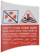 Israel, sea of Galilee, Unauthorized swimming zone No life guard Beware Swimming is forbidden sign in Hebrew English and Arabic a cut out