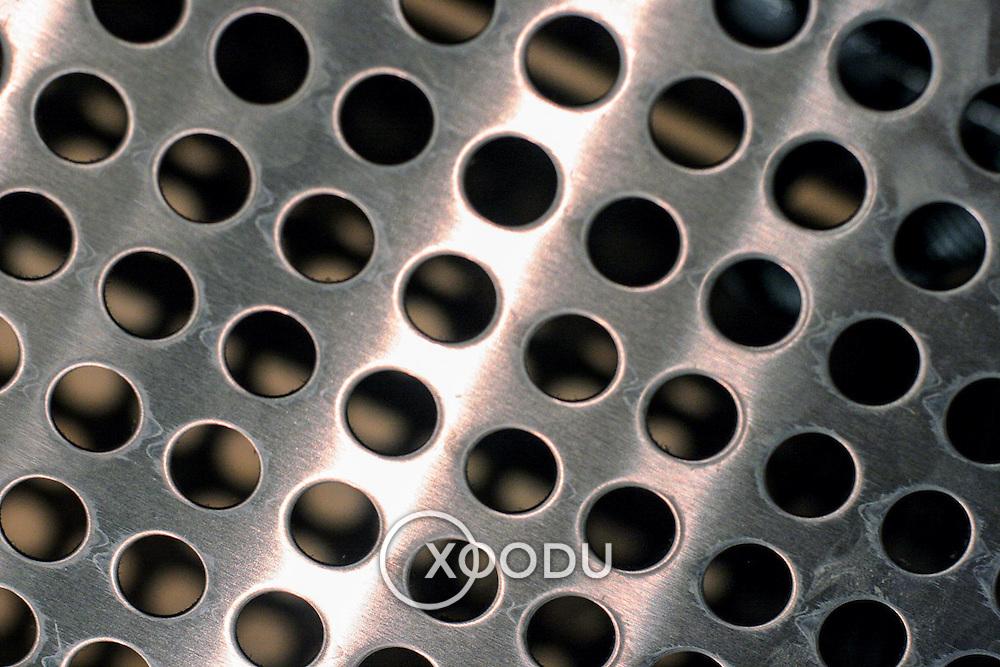 Perforated metal circle pattern (shiny), London, England (May 2007)