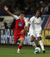 Photo: Paul Thomas.<br /> Bolton Wanderers v Braga. UEFA Cup. 25/10/2007.<br /> <br /> Ricardo Gardner (R) of Bolton battles with Joao Pereira (L). *** Local Caption *** *** UK ONLY ***