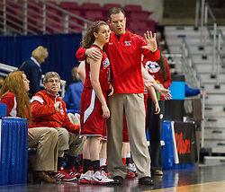 Bridgeport head coach Paul Ayers talks with Bridgeport guard Stephanie Alvaro (11) on the sidelines against Fairmont Senior during a first round game at the Charleston Civic Center.