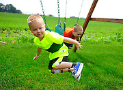 Owen Wills, 3, plays with his brother (right) Liam, 6, in their backyard at the Wills home. Owen is learning to adjust to his prosthetic leg after losing his right leg in a lawn mower accident. Thursday, June 19th, 2014, in New Lennox.
