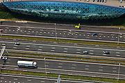 Nederland, Utrecht, Leidsche Rijn, 13-05-20011; autosnelweg A2 ter hoogte van Lage Weide, verbreed naar 2x5 rijstroken. Naast de snelweg het monumentale geluidsscherm, met 'de cockpit' (het druppel-vormig gebouw), autoshowroom voor luxe automobielen van Hessing..A2 motorway near Utrecht, widened to 2x5 lanes. Next to the road a monumental noise barrier (sound screen), with the cockpit (the drop-shaped building), car showroom for luxury automobiles of Hessing, .luchtfoto (toeslag), aerial photo (additional fee required).foto/photo Siebe Swart