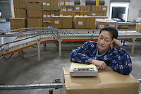 Woman asleep in distribution warehouse