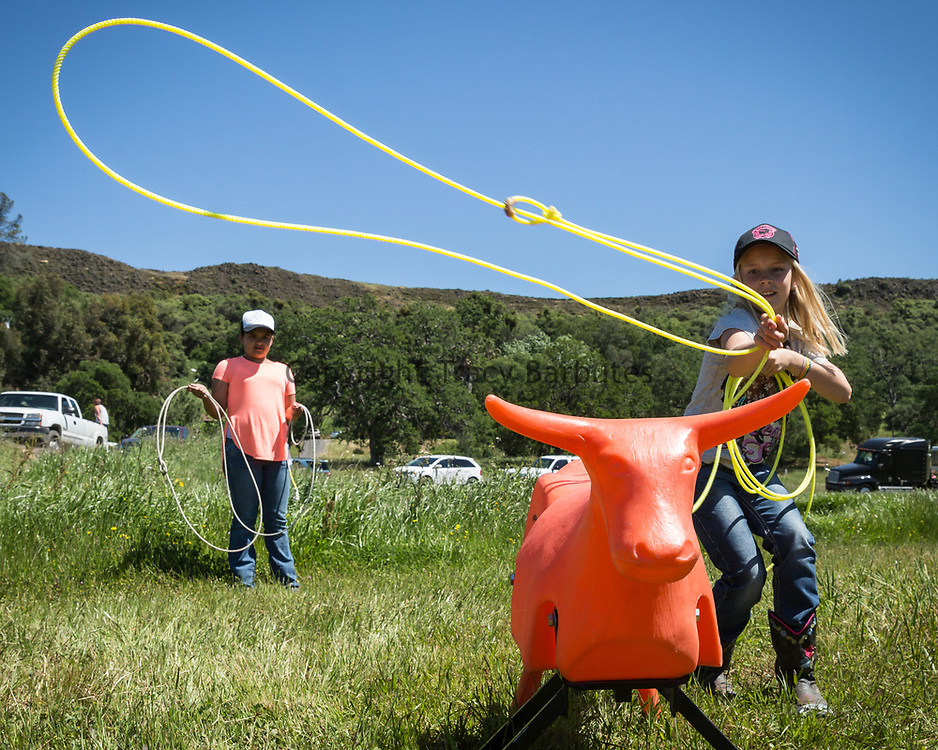 Lillian Guerrero (L), age 12, and Hope Kell, (R), age 9, both of Wilton, CA, practice their roping skills during a break in action at the Tuolumne County Sheriff's Posse 2nd Annual Rawhide Classic American Cowboy Team Roping Association (ACTRA) event on Saturday, April 16, 2016.