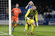 Wycombe Wanderers goalkeeper Stephen Henderson (28), Wycombe Wanderers defender Joe Jacobson, Gillingham striker Tom Eaves (9) holds his face, during the EFL Sky Bet League 1 match between Gillingham and Wycombe Wanderers at the MEMS Priestfield Stadium, Gillingham, England on 15 December 2018.