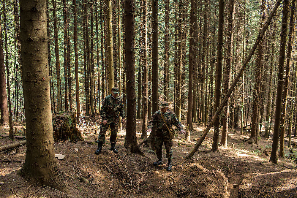 SKOLE, UKRAINE - MAY 1, 2015: Svyatoslav Sheremeta, left, and Volodymyr Kharchuk, director and deputy director of the organization Dolya, respectively, visit the site of a World War II-era mass grave believed to contain the remains of Ukrainian partisans in Skole, Ukraine. Dolya was formed to excavate and repatriate remains from World War II, though its focus is often on locating the graves of Ukrainian partisans killed by Soviet forces. CREDIT: Brendan Hoffman for The New York Times