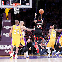 13 January 2014: Miami Heat guard Mario Chalmers (15) goes for the layup past Los Angeles Lakers forward Carlos Boozer (5) and Los Angeles Lakers forward Nick Young (0) during the Miami Heat 78-75 victory over the Los Angeles Lakers, at the Staples Center, Los Angeles, California, USA.
