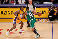 17 June 2010: Forward Paul Pierce of the Boston Celtics dribbles the ball up the court while being guarded by Ron Artest of the Los Angeles Lakers during the second half of the Lakers 83-79 championship victory over the Celtics in Game 7 of the NBA Finals at the STAPLES Center in Los Angeles, CA.