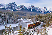 The Canadian Pacific train makes its way along Morants' Curve in Lake Louise, Banff National Park, Canada.