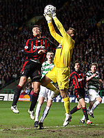 Photo: Paul Thomas.<br /> Glasgow Celtic v AC Milan. UEFA Champions League. Last 16, 1st Leg. 20/02/2007.<br /> <br /> Alberto Gilaedino (L) of Milan and keeper Artur Boruc go for the ball.