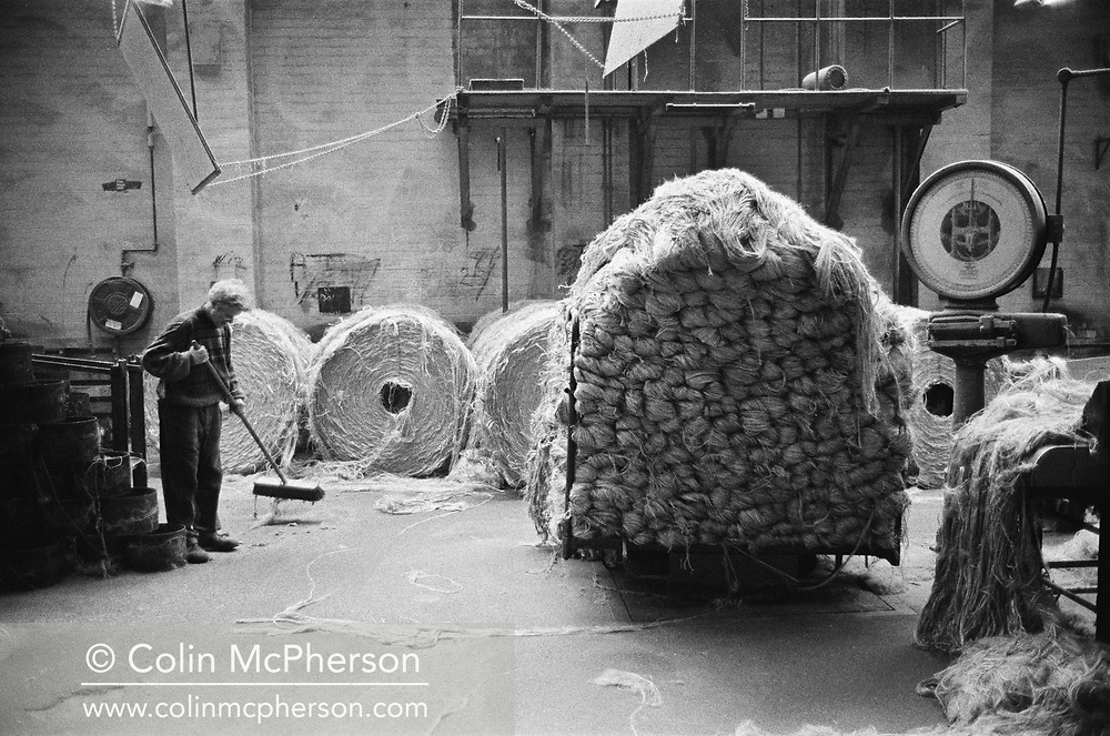 A worker sweeping the floor at Tay Spinners mill in Dundee, Scotland. This factory was the last jute spinning mill in Europe when it closed for the final time in 1998. The city of Dundee had been famous throughout history for the three 'Js' - jute, jam and journalism.
