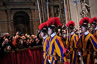 VATICAN CITY - 12 MARCH 2013: After the Pro Eligendo Pontifice Mass, or the Mass for the Election of the Roman Pontiff, the Swiss guards march from the nave towards the exit of Saint Peter's Basilica, in Vatican City, on March 12, 2013...After the mass, the 115 cardinals are set to enter the conclave to elect a successor to Pope Benedict XVI after he became the first pope in 600 years to resign from the role. The conclave will take place inside the Sistine Chapel and will be attended by 115 cardinals as they vote to select the 266th Pope of the Catholic Church.