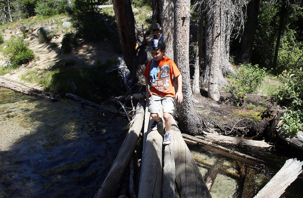 Jeffrey Beller, 6, of Boise, ID crosses a stream on the trail to Goat Lake in the Sawtooth Mountains of central Idaho on Sunday July 14, 2013.