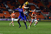 Oldham Athletic Midfielder, Timothe Dieng and Blackpool Striker Mark Cullen during the Sky Bet League 1 match between Blackpool and Oldham Athletic at Bloomfield Road, Blackpool, England on 16 February 2016. Photo by Pete Burns.