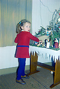 little girl posing with Christmas stable about 1970