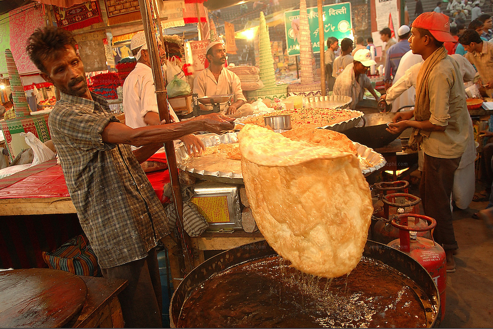 On the last day of the Ramadan, a temporary stall is set up near the gate of the Jama Masjid in Old Delhi to sell Halwa Paratha, a famous combination of sweet fried bread and confectionery, to people coming out of the mosque after the break of the fast.