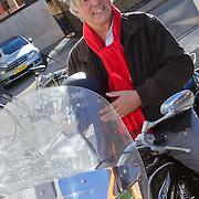 NLD/Hilversum/20111104- Perspresentatie najaar 2011 / 2012 omroep Max, Ron Brandsteder met Ajax sjaal op zijn motor