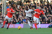 Fulham striker Sone Aluko (24) and Brighton & Hove Albion midfielder Oliver Norwood (21) during the EFL Sky Bet Championship match between Fulham and Brighton and Hove Albion at Craven Cottage, London, England on 2 January 2017.