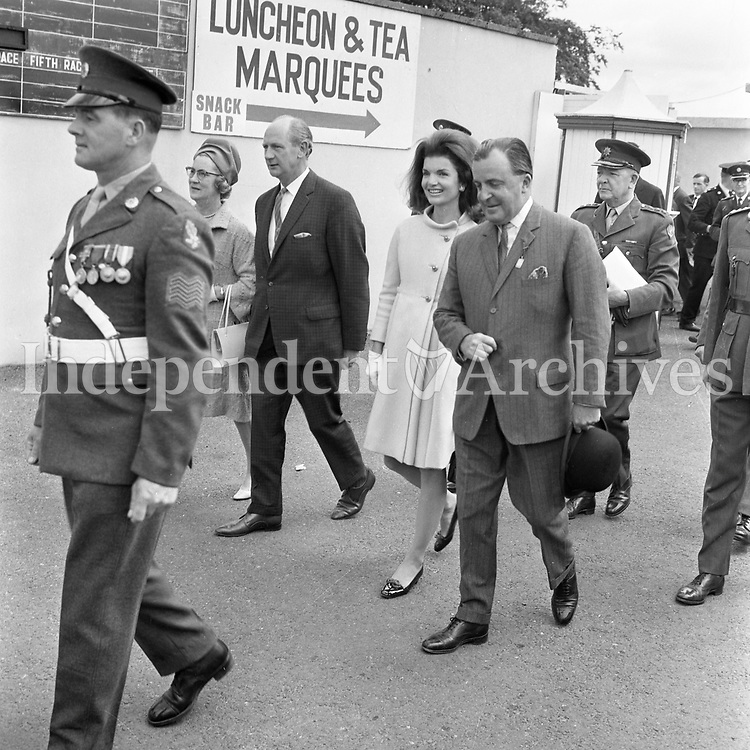 Jacqueline Kennedy's 1967 visit to Ireland.<br /> Mrs. Jackie Kennedy at The Curragh, 1st July 1967.<br /> An Taoiseach Mr. Jack Lynch T.D. and his wife M&aacute;ir&iacute;n walk with her.<br /> A caption on Monday 3rd July 1967 in The Irish Independent, P.7: 'Jacqueline Kennedy accompanied by the Taoiseach Mr. Lynch, on her arrival at the Curragh on Saturday to attend the Irish Sweeps Derby.'<br /> (Part of the Independent Ireland Newspapers/NLI Collection)