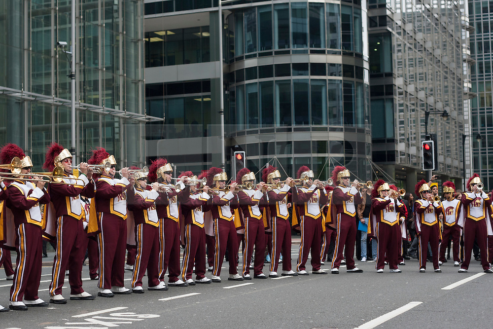 © licensed to London News Pictures. London, UK 17/05/2012.The Trojan Marching Band of the University of Southern California performing outside Canada Square Park in Canada Square Park this evening (17/05/12). Photo credit: Tolga Akmen/LNP