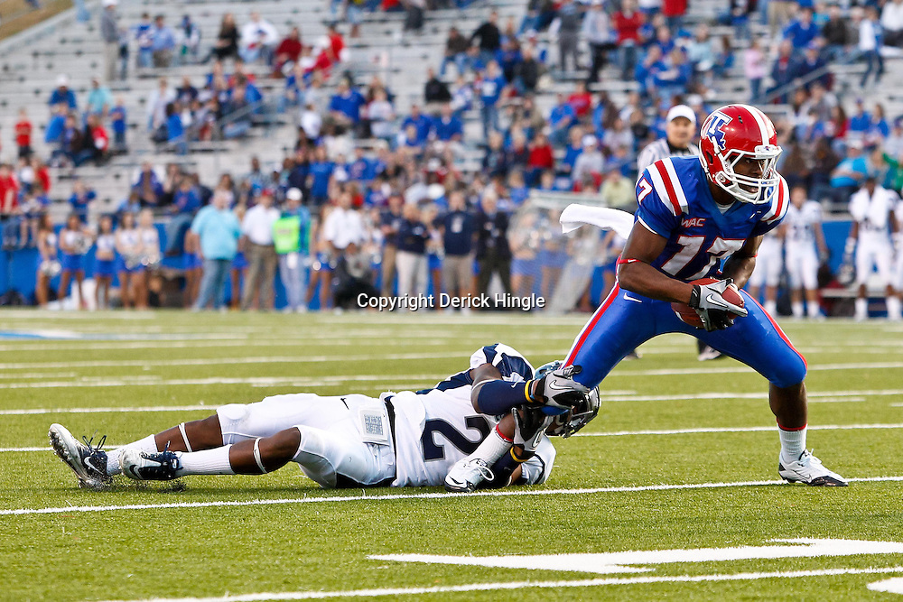 December 4, 2010; Ruston, LA, USA;  Louisiana Tech Bulldogs wide receiver Taulib Ikharo (17) is grabbed by Nevada Wolf Pack cornerback Khalid Wooten (2) during the second half at Joe Aillet Stadium.  Nevada defeated Louisiana Tech 35-17. Mandatory Credit: Derick E. Hingle