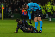 Dame N'Doyle of FC Copenhagen is on the floor looking for treatment during the Europa League match between Celtic and FC Copenhagen at Celtic Park, Glasgow, Scotland on 27 February 2020.