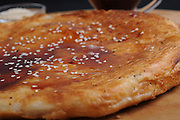 Malawach or malawah is a fried bread originally of Yemen. Malawach resembles a thick pancake, and it consists of hundreds of thin layers of puff pastry. It is usually fried. served with hard-boiled egg tomato puree and hot peppers