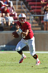PALO ALTO, CA - OCTOBER 06: Quarterback Josh Nunes #6 of the Stanford Cardinal scrambles out of the pocket against the Arizona Wildcats during the fourth quarter at Stanford Stadium on October 6, 2012 in Palo Alto, California. The Stanford Cardinal defeated the Arizona Wildcats 54-48 in overtime. (Photo by Jason O. Watson/Getty Images) *** Local Caption *** Josh Nunes