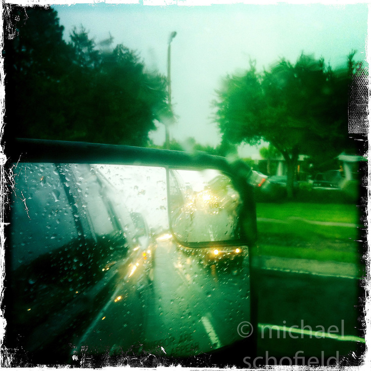 Road in rain, Orlando, holiday 2012. Photo taken with the Hipstamatic photo application on Apple iPhone 4.
