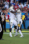 Los Angeles Chargers rookie defensive tackle Justin Jones (91) jumps on and celebrates with Los Angeles Chargers defensive end Isaac Rochell (98) as the pair of defenders celebrate after Rochell intercepts a late fourth quarter pass that allows the Chargers to run out the clock and win the game during the NFL week 4 regular season football game against the San Francisco 49ers on Sunday, Sept. 30, 2018 in Carson, Calif. The Chargers won the game 29-27. (©Paul Anthony Spinelli)