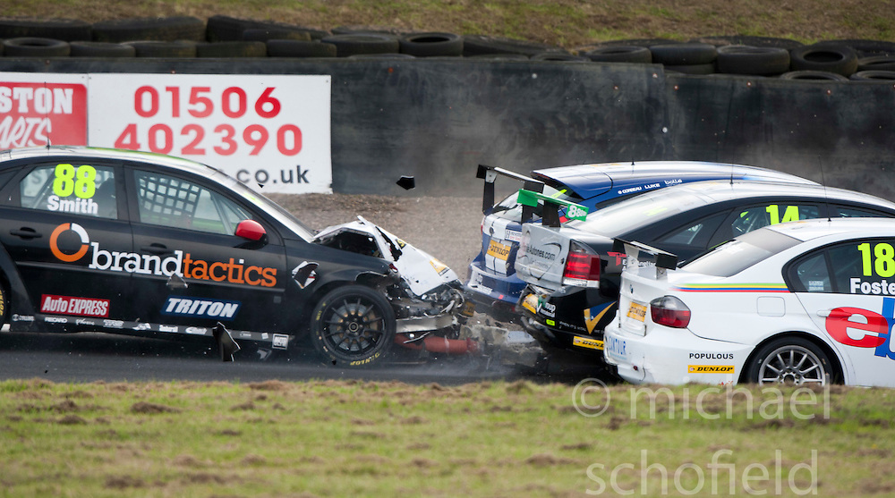 Car 88  - Aron Smith crashes as the safety car causes confusion at the Real Radio Hairpin..British Touring Car Championship at Knockhill, Sunday 4th September 2011. .© pic Michael Schofield.