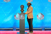 Aug 3, 2019; Canton, OH, USA; Ed Reed poses with bust during the Pro Football Hall of Fame Enshrinement at Tom Benson Hall of Fame Stadium. (Robin Alam/Image of Sport)