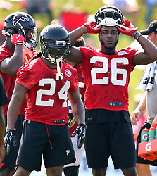 July 27, 2017 - Flowery Branch, GA, USA - Atlanta Falcons running backs Devonta Freeman, left, and Tevin Coleman get in some work on the first day of team practice at training camp on Thursday, July 27, 2017, in Flowery Branch, Ga. (Credit Image: © Curtis Compton/TNS via ZUMA Wire)