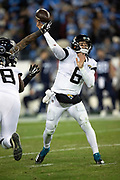Jacksonville Jaguars quarterback Cody Kessler (6) gets his arm hit by a defender as he throws a pass during the week 14 regular season NFL football game against the Tennessee Titans on Thursday, Dec. 6, 2018 in Nashville, Tenn. The Titans won the game 30-9. (©Paul Anthony Spinelli)