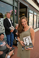 Huntington, New York, U.S. - August 6, 2014 - REGINA ROSE MAZZARELLI, 28, of Bohemia, is waiting on line to attend the book signing for H. Clinton's new memoir, Hard Choices, at the Book Revue in Huntington, Long Island. Clinton's book is about her four years as America's 67th Secretary of State and how they influence her view of the future.