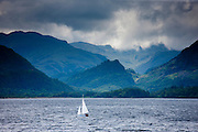 Sailing yacht on Derwent Water at Friar's Crag near Keswick in the Lake District National Park, Cumbria, UK