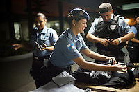 Women UPP officers prepare for their shift, in Complexo do Caju, Rio de Janeiro, Brazil, on Friday May 10, 2013.<br /> <br /> In the early hours of Sunday, March 3, 2013, about 1,400 Brazilian security forces occupied 13 communities during a joint public security operation to install a Pacifying Police Unit (UPP) in two Rio de Janeiro favelas, Complexo do Caju and Barreira do Vasco. Elite police units backed by armored military vehicles and helicopters invaded the neighborhood in an on-going policing program aimed to drive violent and heavily armed drug gangs out of Rio's poor communities, where the traffickers have ruled for decades. For the community of Caju, that is ADA (Amigos de Amigos) and CV (Comando Vermelho).