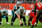 Carolina Panthers Quarterback Kyle Allen (7) takes the snap from Carolina Panthers Offensive Linesman Matt Paradis (61) during the International Series match between Tampa Bay Buccaneers and Carolina Panthers at Tottenham Hotspur Stadium, London, United Kingdom on 13 October 2019.