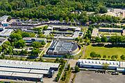 Nederland, Noord-Brabant, Vught, 13-05-2019; PI Vught - Penitiaire Inrichting Vught, overzicht, het complex huisvest onder andere de gevangenis, Huis van Bewaring (HvB) en Extra beveiligde inrichting (EBI) - het halfronde gebouw. Verder op het terrein Inrichting voor Stelselmatige Daders (ISD), , Terroristen Afdeling (TA), Beheersproblematische Gedetineerden (BPG), Langdurige Forensische Psychiatrische Zorg (LFPZ), Zeer intensieve Specialistische Zorg (ZISZ) als een Penitentiair Psychiatrisch Centrum (PPC).<br /> Prison complex Vught.