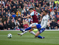 Ashley Westwood of Burnley (L) has a shot at goal - Mandatory by-line: Jack Phillips/JMP - 13/04/2019 - FOOTBALL - Turf Moor - Burnley, England - Burnley v Cardiff City - English Premier League