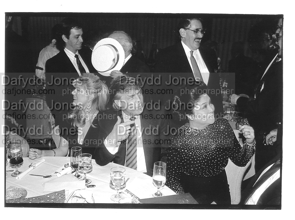 Marla maples, donald trump and imelda Marcos© Copyright Photograph by Dafydd Jones 66 Stockwell Park Rd. London SW9 0DA Tel 020 7733 0108 www.dafjones.com